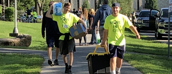 students moving in to campus housing