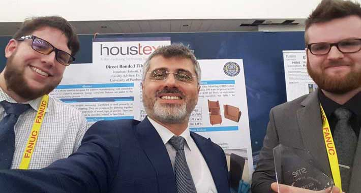 Pitt-Johnstown mechanical engineering students Jonathan Holman and Tanner Badoud won the Most Creative Design Award in the 3D Printing Student Competition at HOUSTEX 2019 in February 2019.