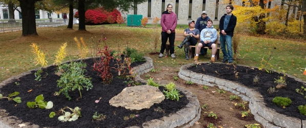 Green Team students and the finished product in front of Owen Library