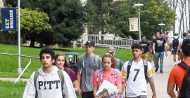 Group of students walking through campus